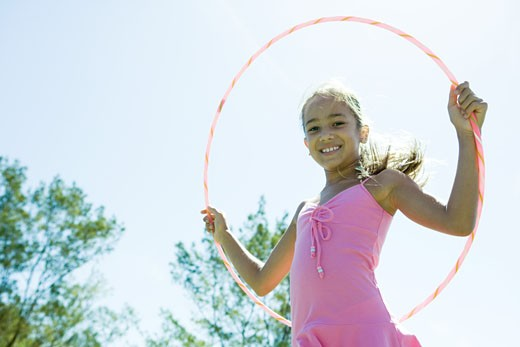 Stock Photo: 1569R-9019424 Girl with hoola hoop