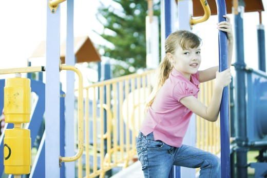 Stock Photo: 1569R-9019523 Child on playground equipment