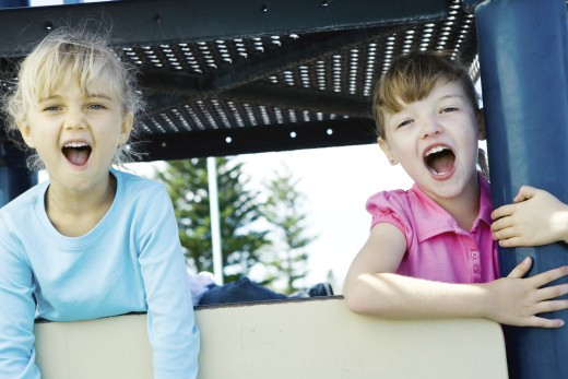 Children on playground equipment : Stock Photo