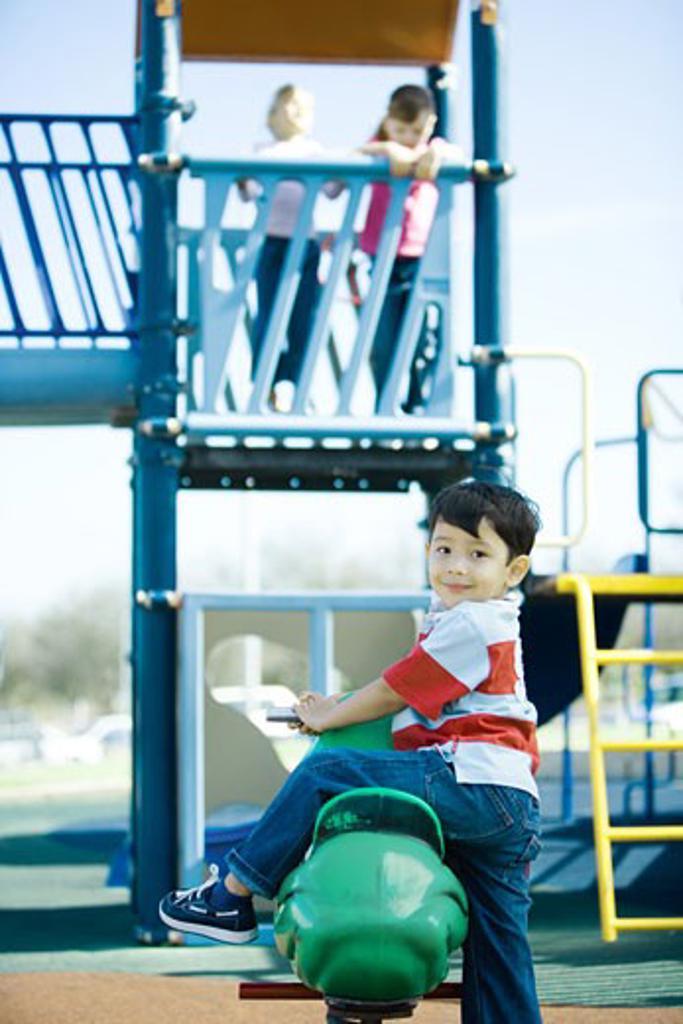 Stock Photo: 1569R-9019790 Children on playground equipment