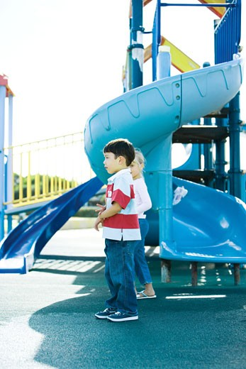 Stock Photo: 1569R-9020025 Children on playground equipment