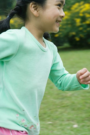 Little girl running, close-up : Stock Photo