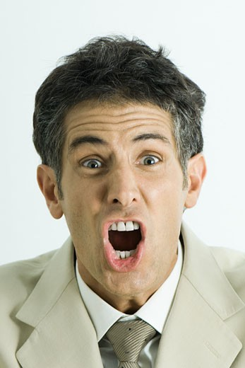 Man screaming, looking at camera, head and shoulders, portrait : Stock Photo