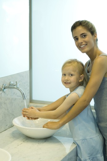 Stock Photo: 1569R-9022231 Mother and daughter washing hands together