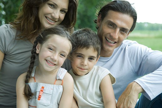 Stock Photo: 1569R-9022261 Family outdoors, smiling at camera, portrait
