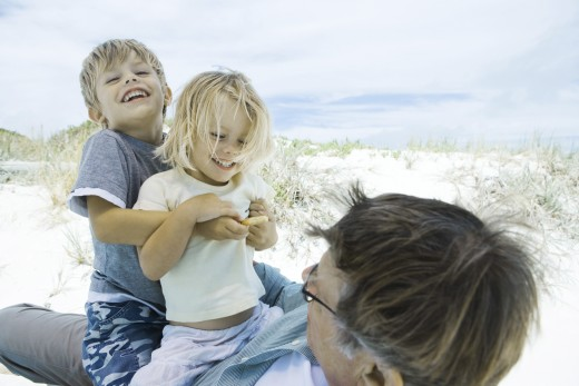 Stock Photo: 1569R-9023377 Family on beach