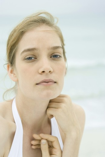 Young woman, head and shoulders, portrait, sea in background : Stock Photo