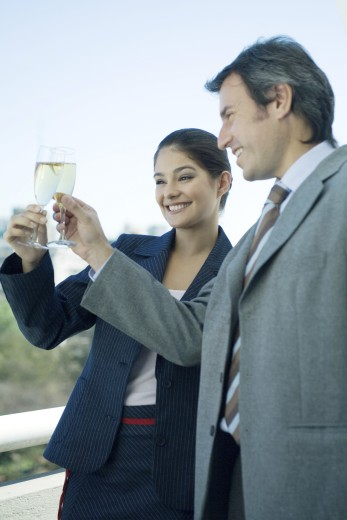Stock Photo: 1569R-9023742 Business partners clinking glasses of champagne