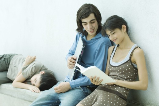Young friends reading book together : Stock Photo