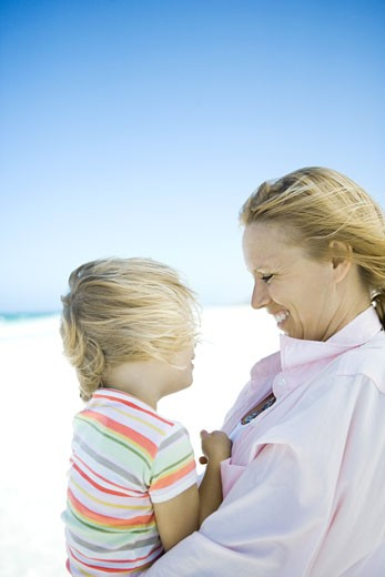 Little girl with mother on beach : Stock Photo