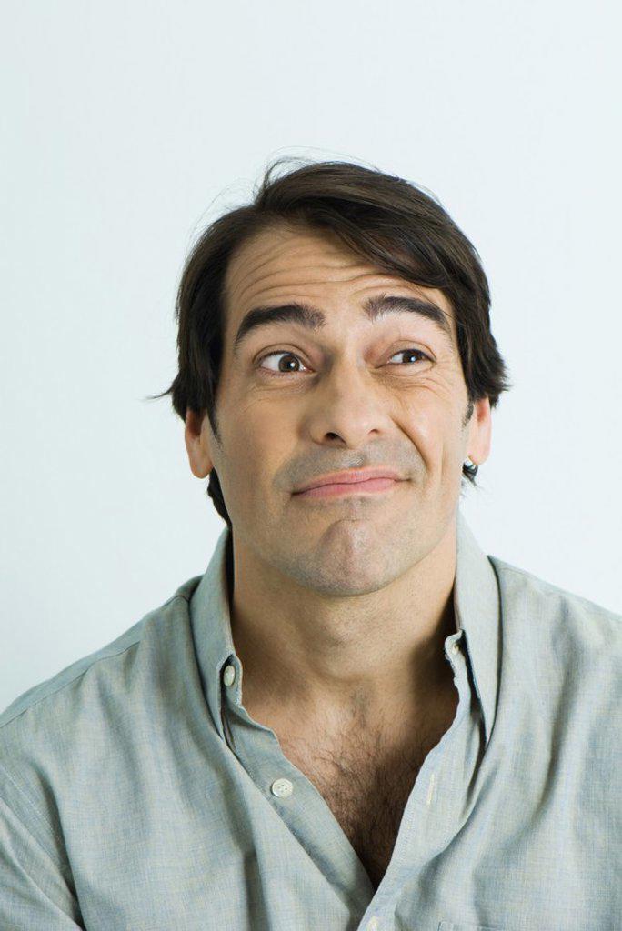 Stock Photo: 1569R-9024735 Man making face, portrait