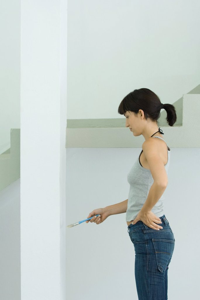 Woman painting post : Stock Photo