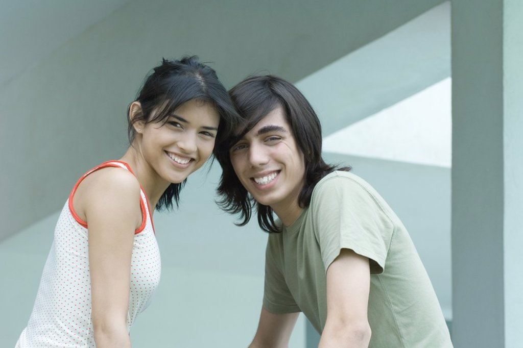 Young male and female friends, waist up, looking at camera : Stock Photo