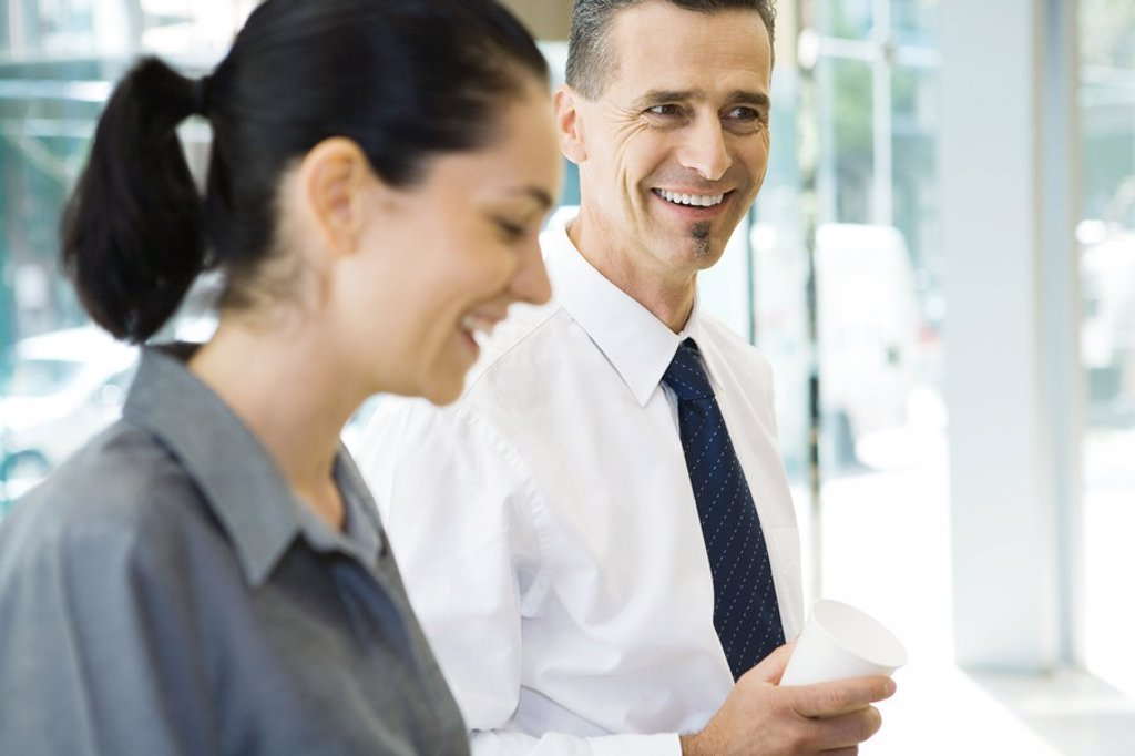 Stock Photo: 1569R-9026493 Two business associates laughing