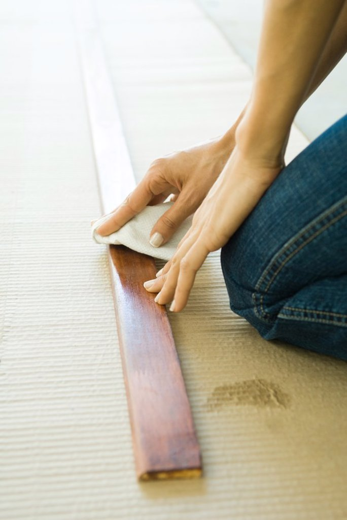 Stock Photo: 1569R-9026973 Woman preparing wood plank, cropped view