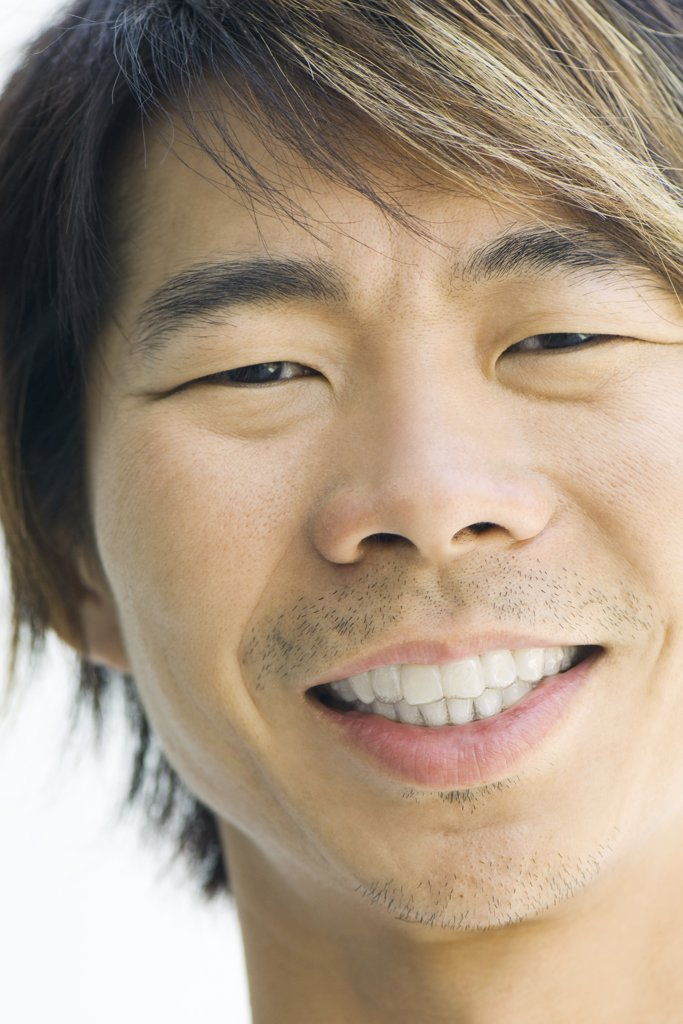 Man smiling at camera, cropped portrait : Stock Photo