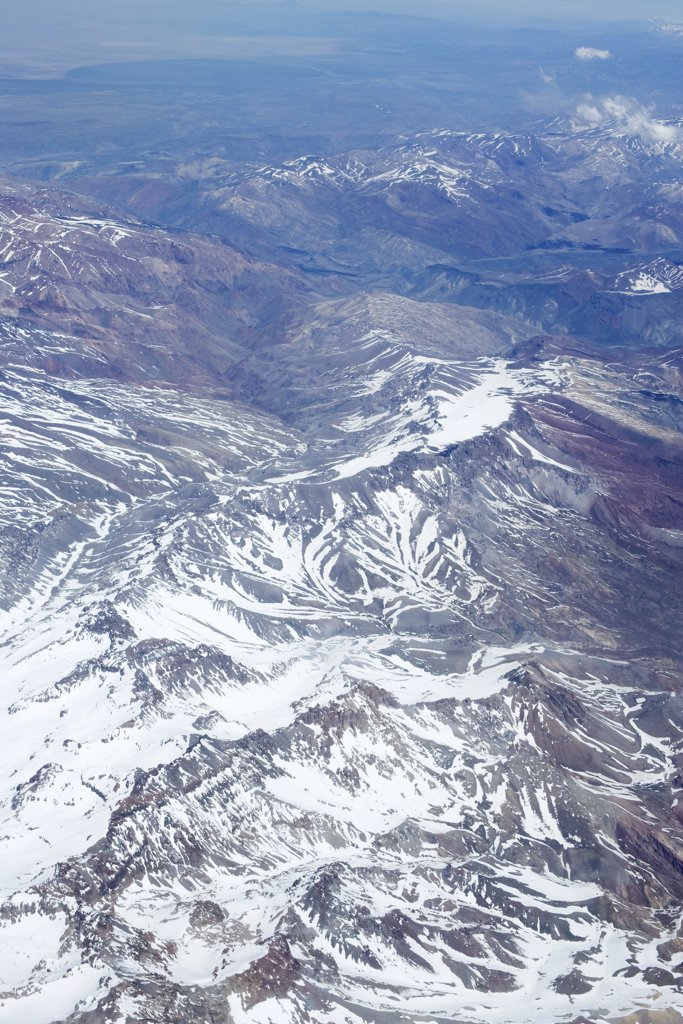 Stock Photo: 1569R-9028401 Snow-covered mountain range, aerial view