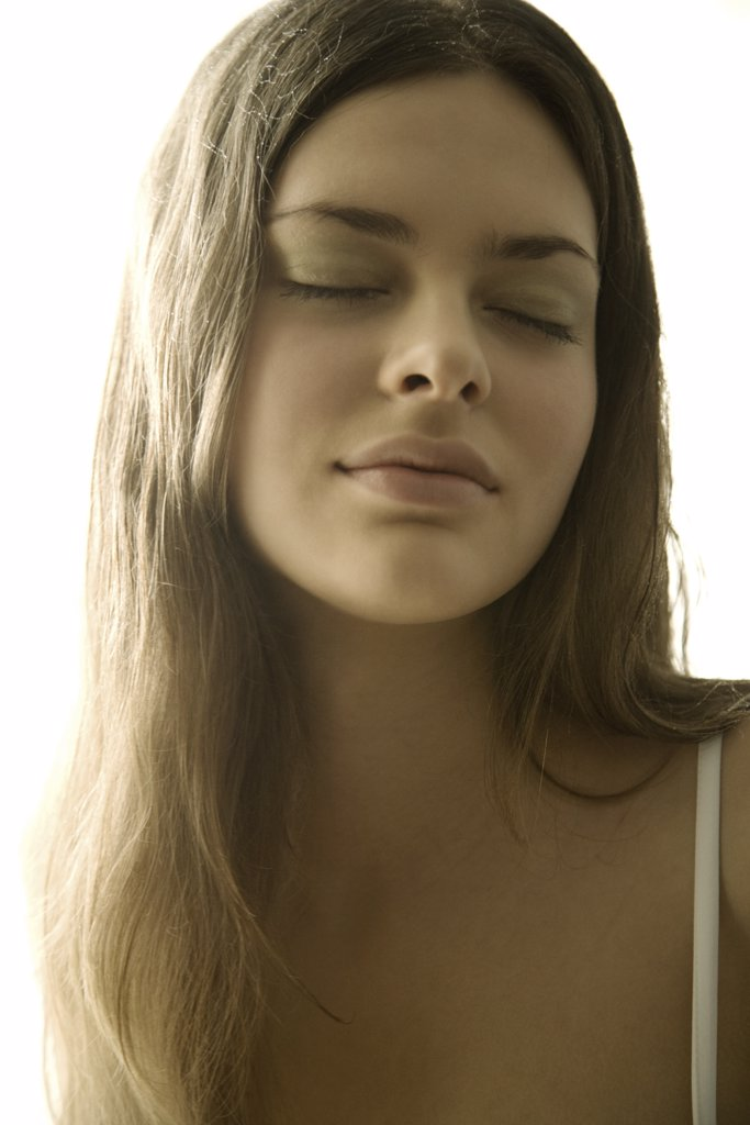 Young woman eyes closed, portrait, close-up : Stock Photo