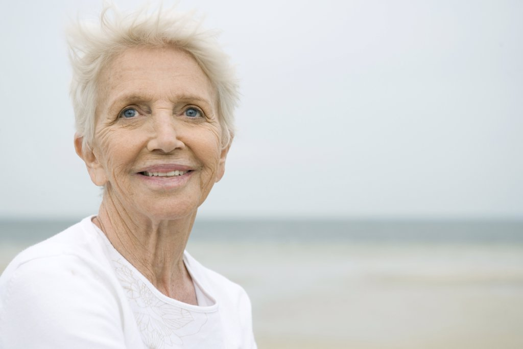 Stock Photo: 1569R-9031139 Senior woman smiling, looking away, portrait
