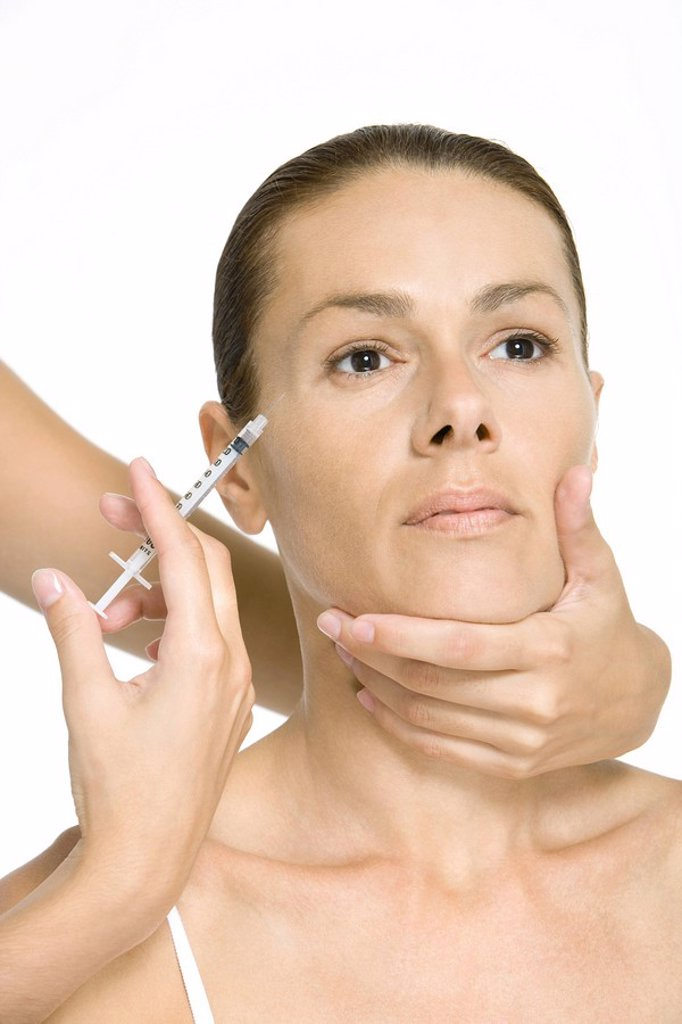 Woman receiving Botox injection : Stock Photo