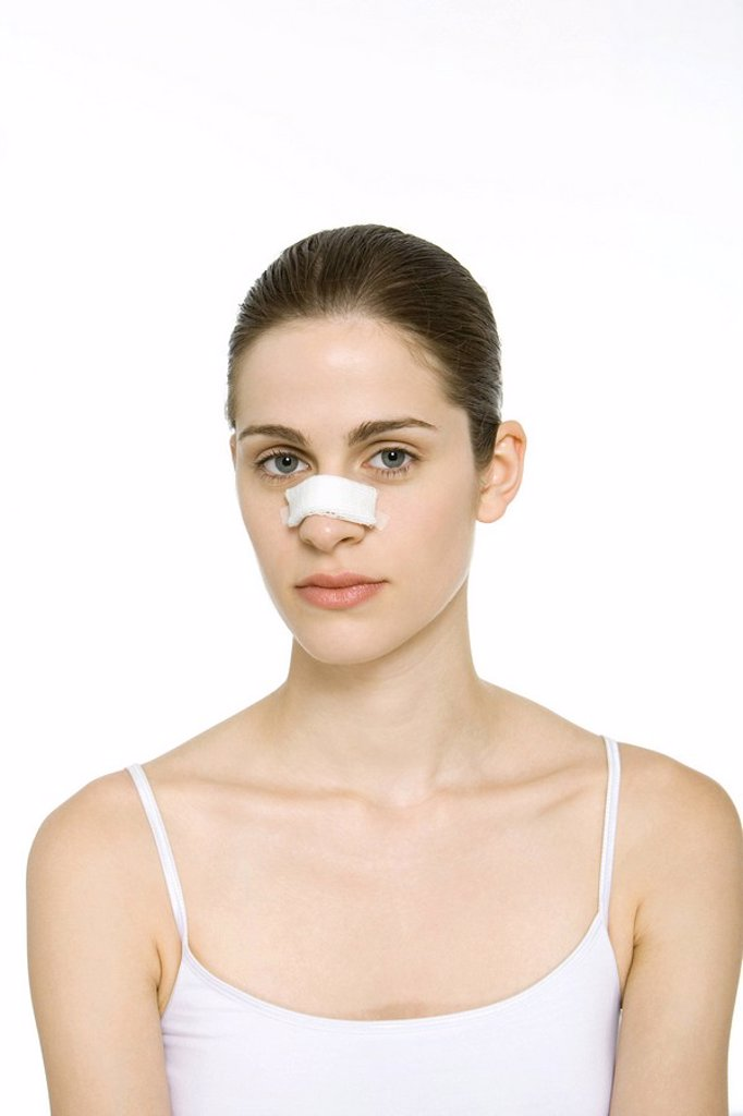 Stock Photo: 1569R-9035130 Young woman with bandage on nose, looking at camera, portrait