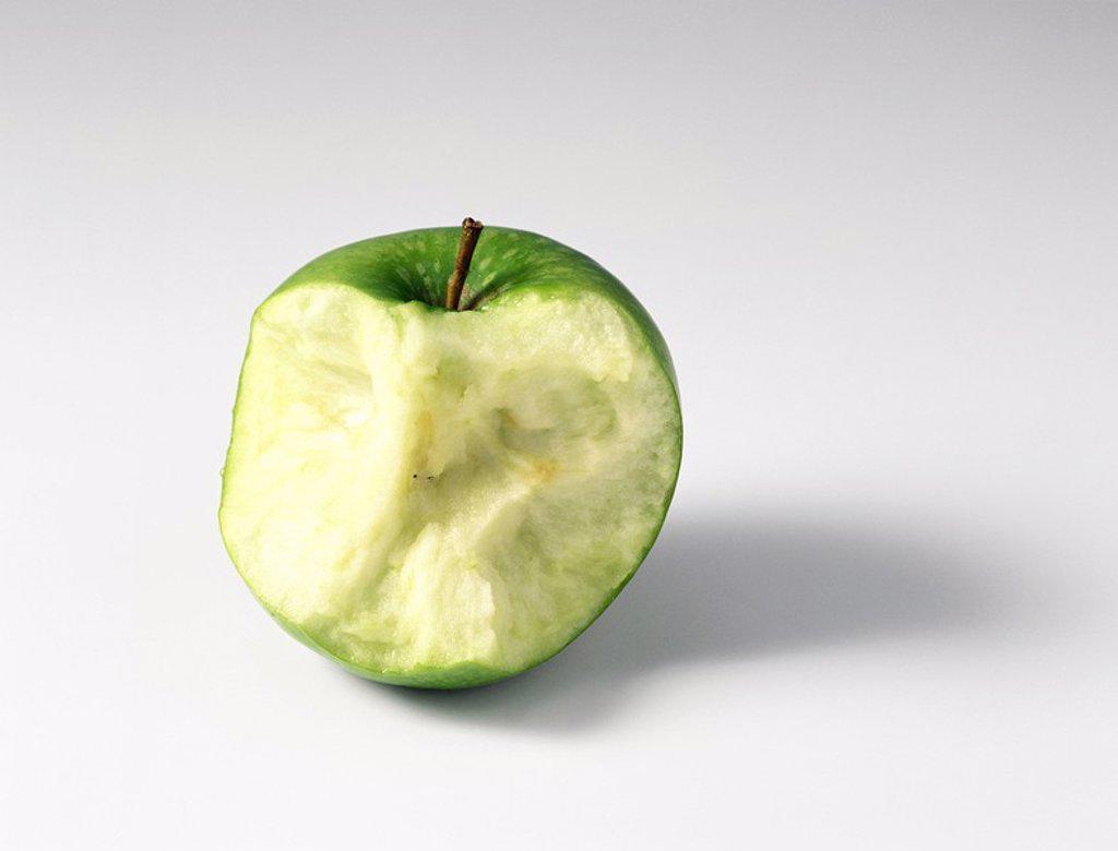 Partially eaten apple, close-up : Stock Photo