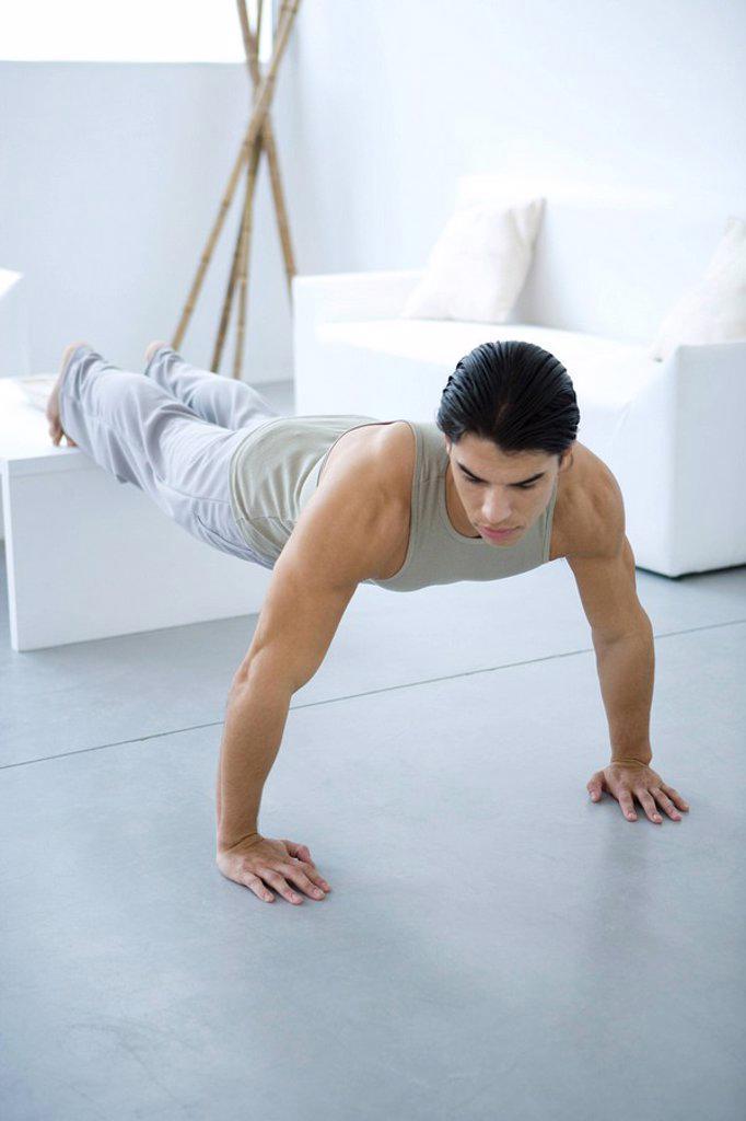 Man doing push-ups : Stock Photo
