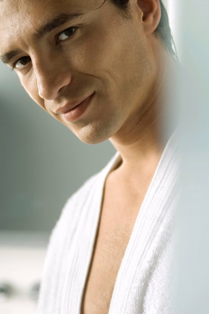 Stock Photo: 1569R-9036912 Man in bathrobe smiling seductively at camera, cropped