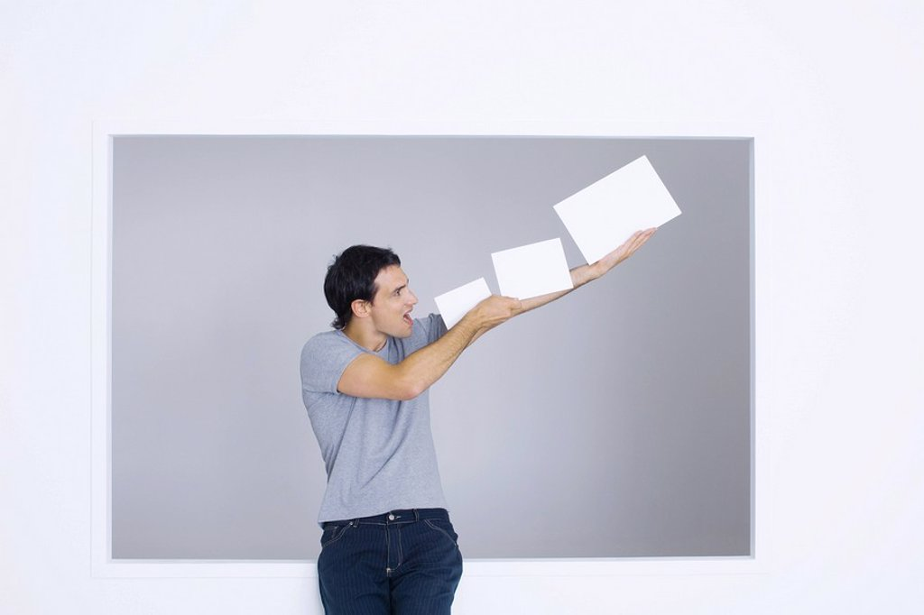 Man holding up blank papers, shouting : Stock Photo