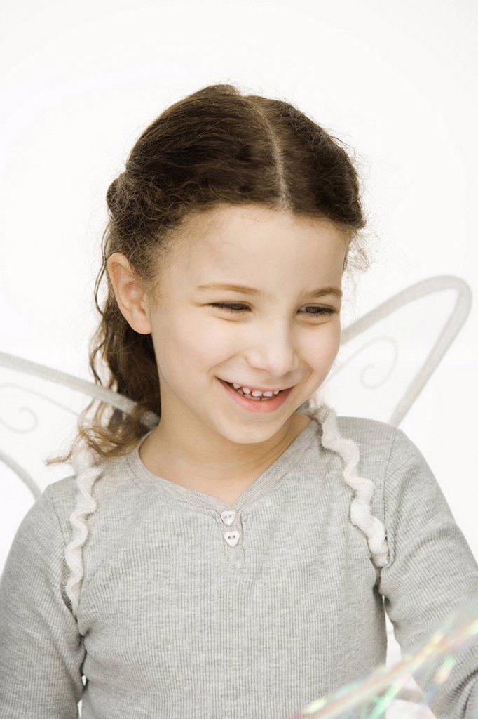 Stock Photo: 1569R-9037597 Little girl wearing wings, smiling, portrait