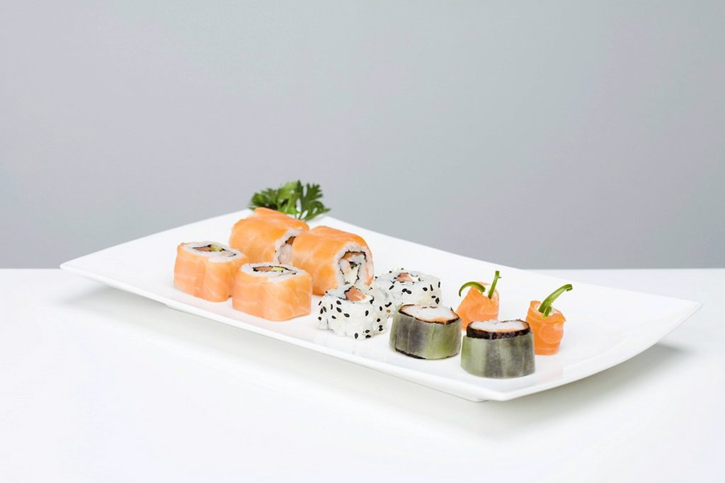 Stock Photo: 1569R-9037962 Assorted maki sushi arranged on sushi plate