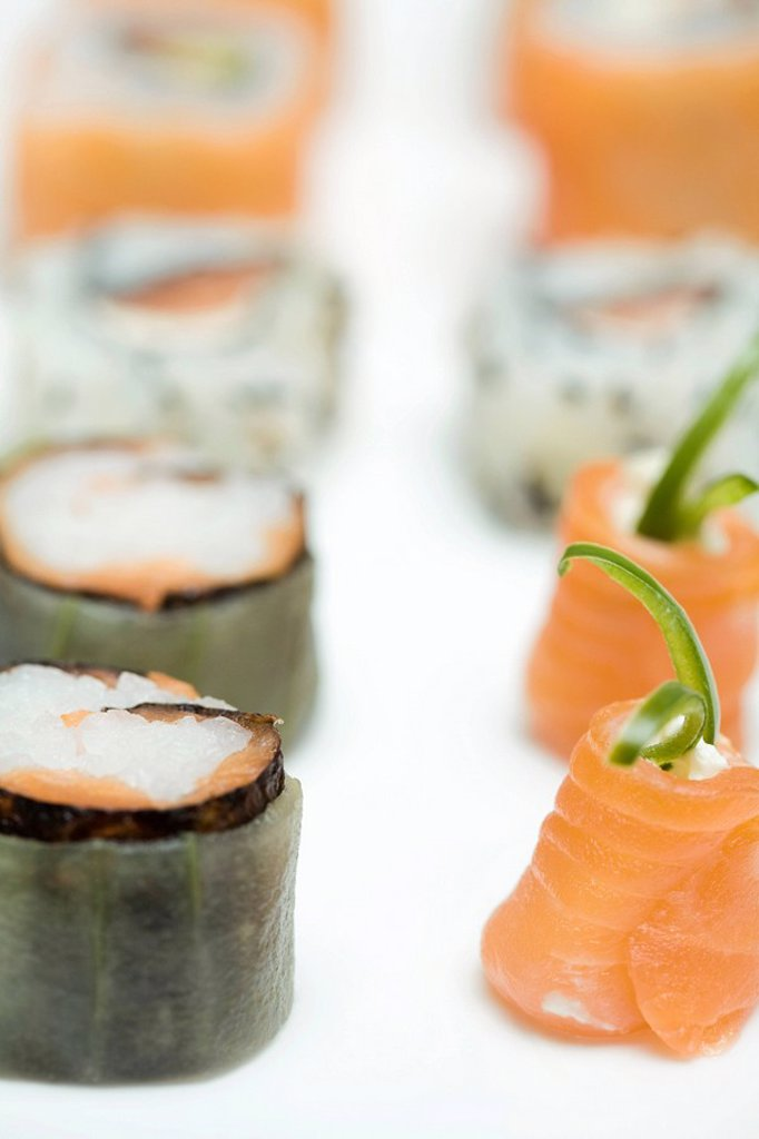Stock Photo: 1569R-9037995 Cropped view of assorted maki sushi, close-up