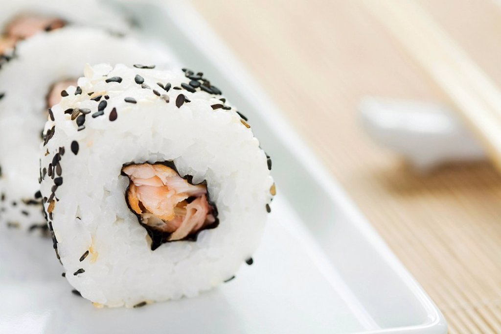 Stock Photo: 1569R-9038005 Maki sushi rolled in black sesame seeds, close-up