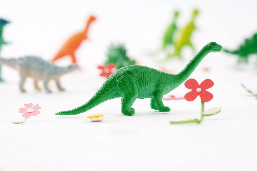 Stock Photo: 1569R-9038766 Toy dinosaurs in artificial garden