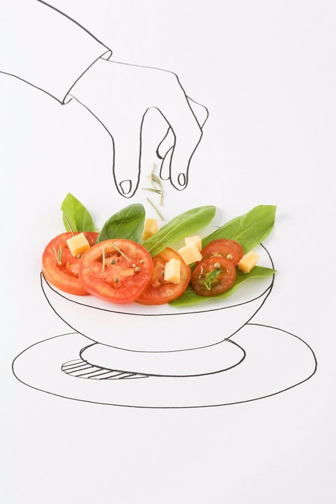 Drawing of hand sprinkling seasonings on salad : Stock Photo