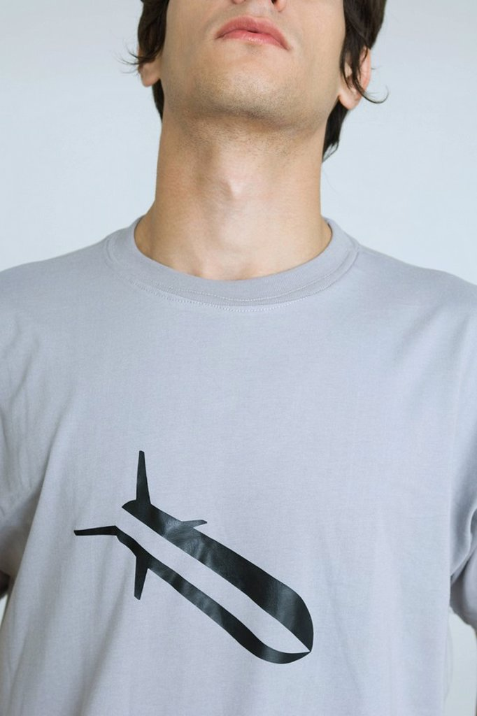Young man wearing tee-shirt with bomb graphic, cropped : Stock Photo