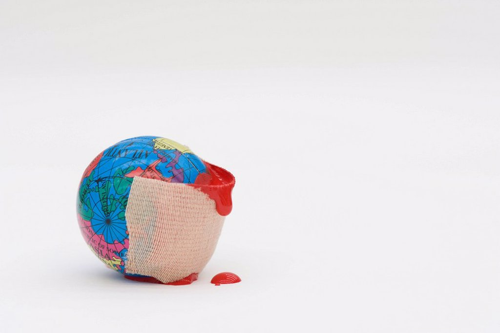 Adhesive bandage dripping blood wrapped around globe : Stock Photo