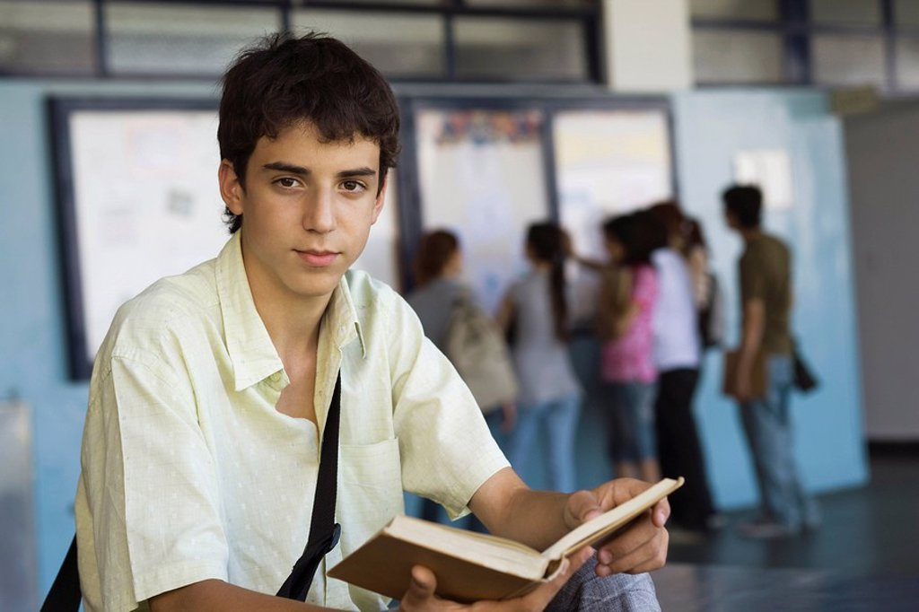 Teenage boy reading book : Stock Photo