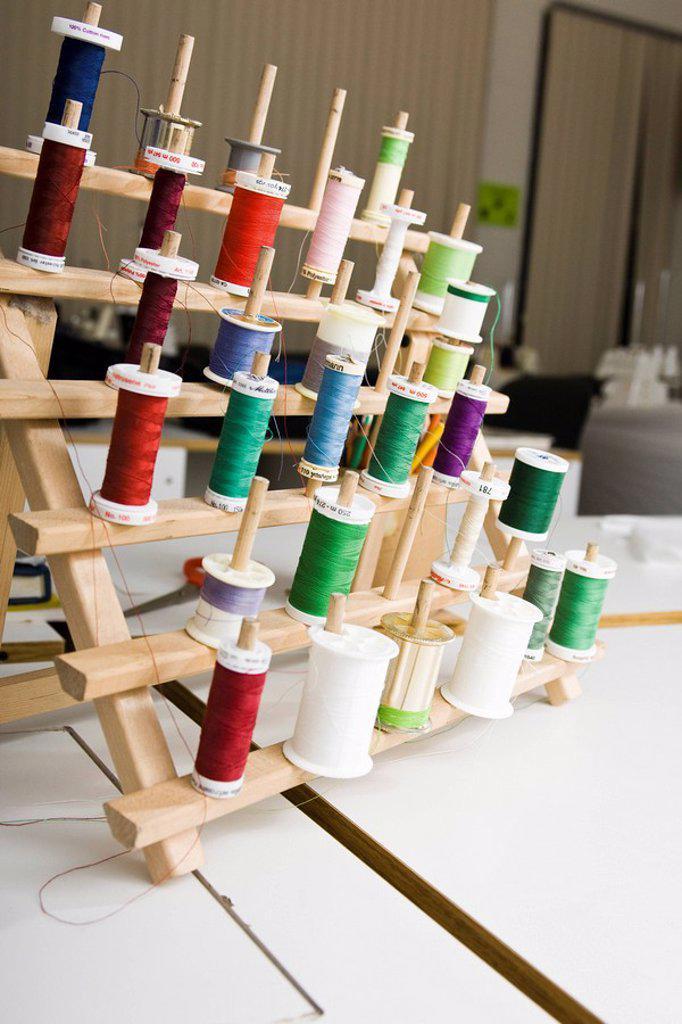 Stock Photo: 1569R-9040679 Spools of thread on rack