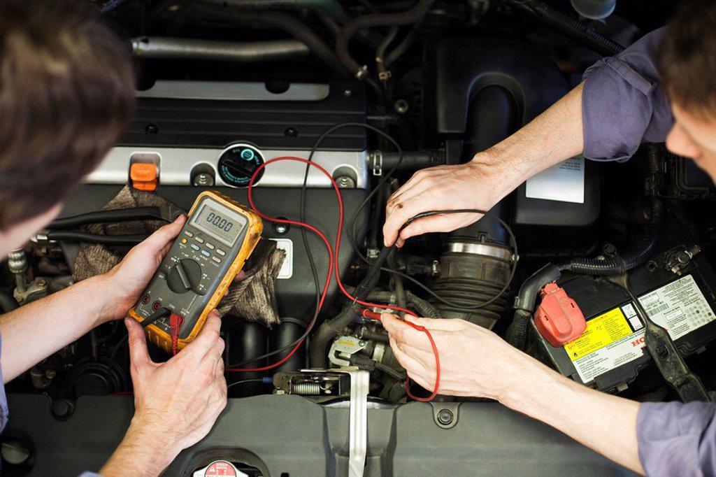 Mechanics tuning car engine : Stock Photo