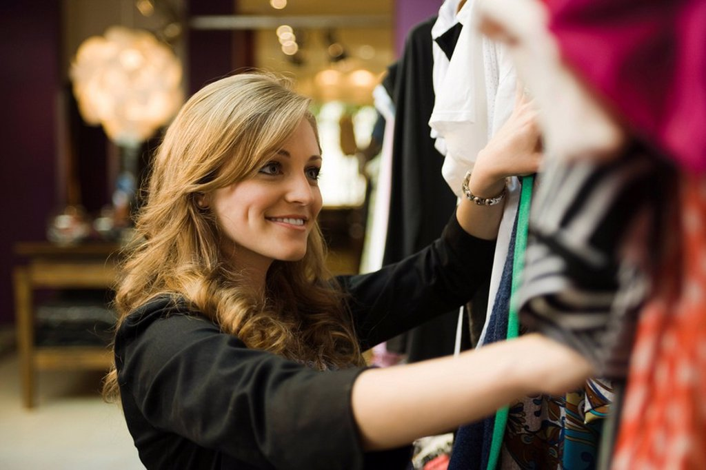 Stock Photo: 1569R-9041584 Woman shopping in clothing boutique