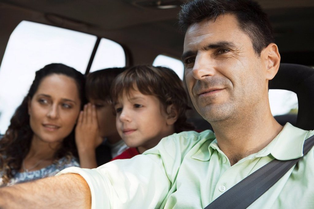 Man driving with his family : Stock Photo