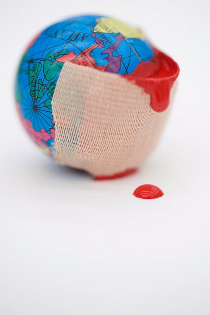 Stock Photo: 1569R-9041734 Adhesive bandage dripping blood wrapped around globe