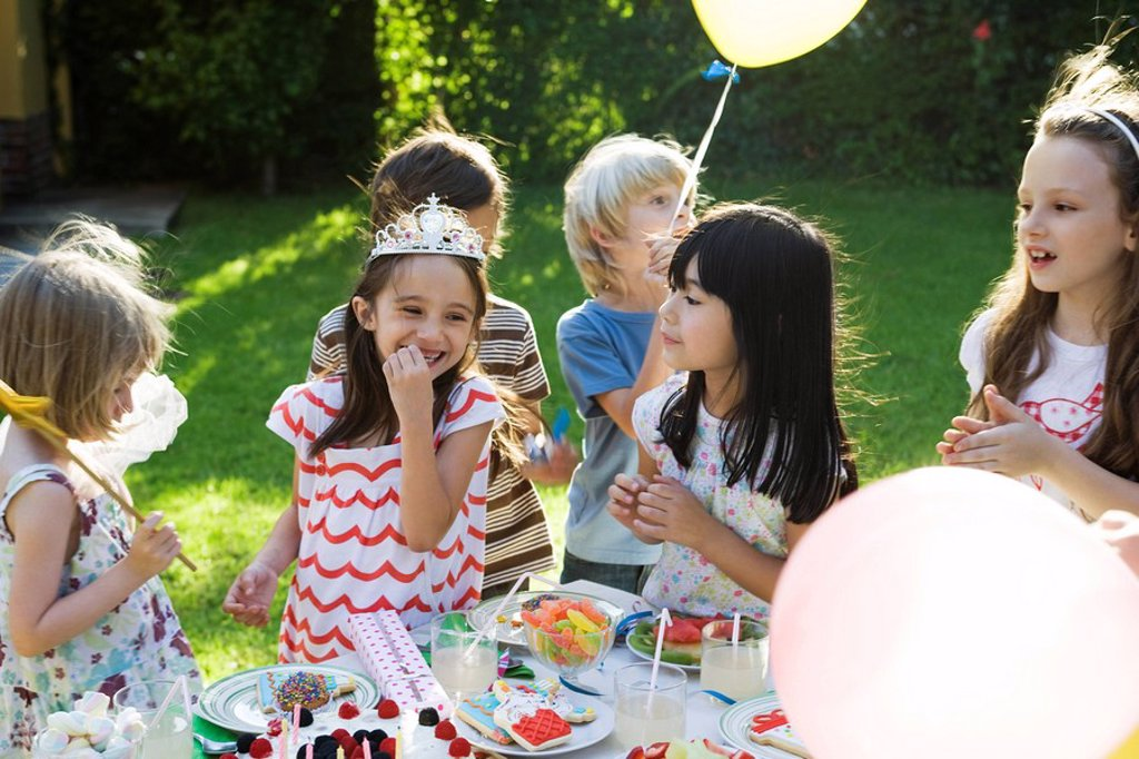 Stock Photo: 1569R-9042119 Children eating sweets at birthday party
