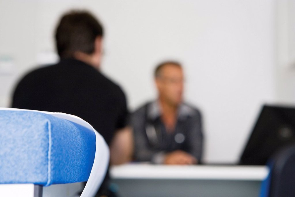 Doctor consulting patient in clinic : Stock Photo
