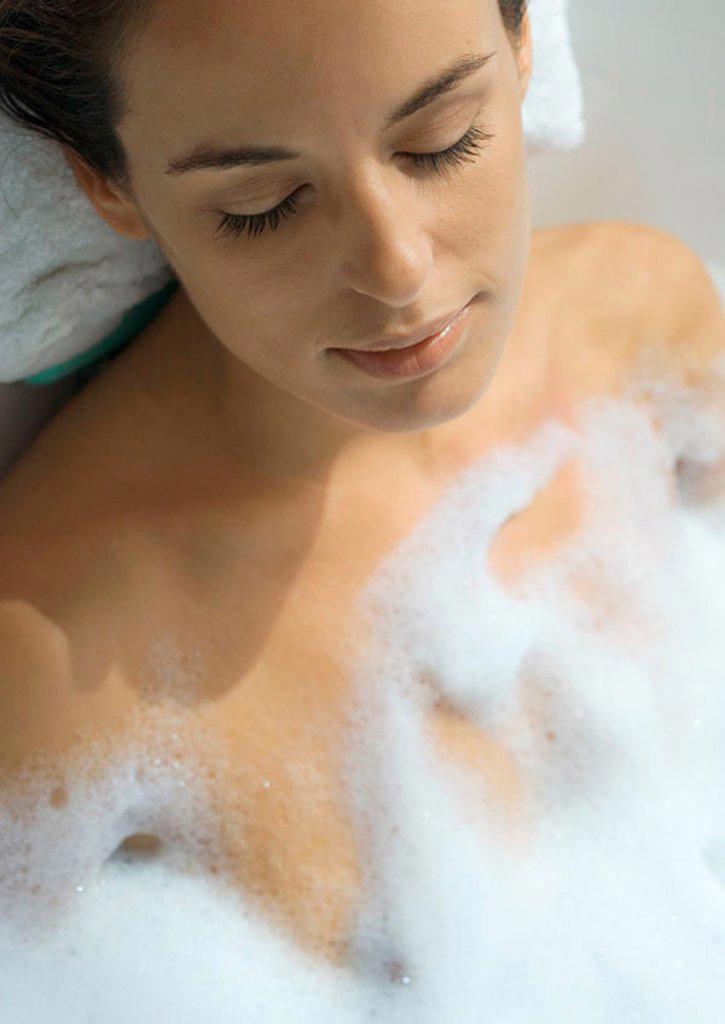 Stock Photo: 1569R-9044963 Woman taking bubble bath