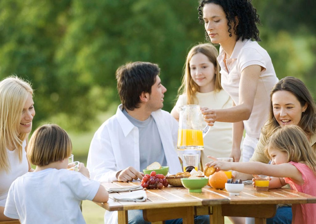 Group having breakfast outdoors : Stock Photo
