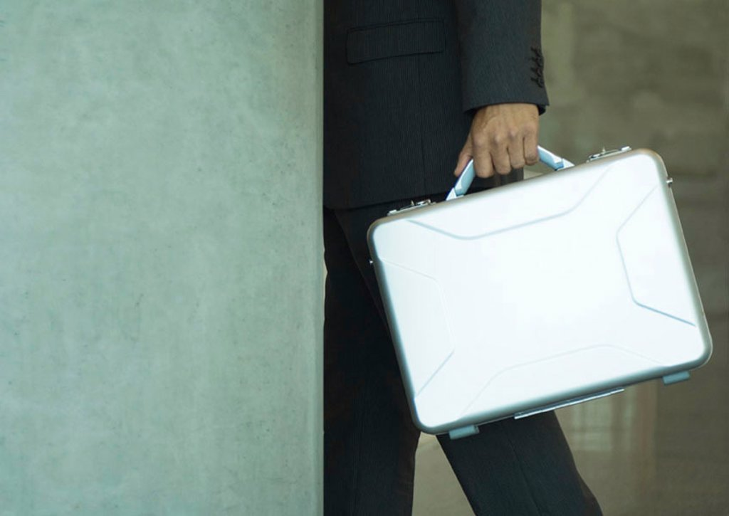 Briefcase being carried : Stock Photo