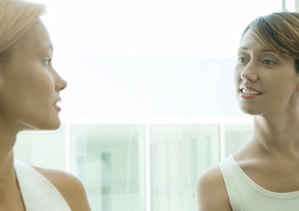 Two women speaking to each other : Stock Photo
