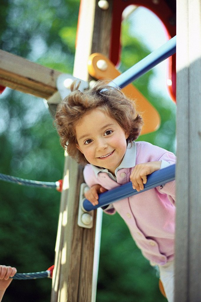 Stock Photo: 1569R-9054763 Little girl playing on jungle gym, portrait